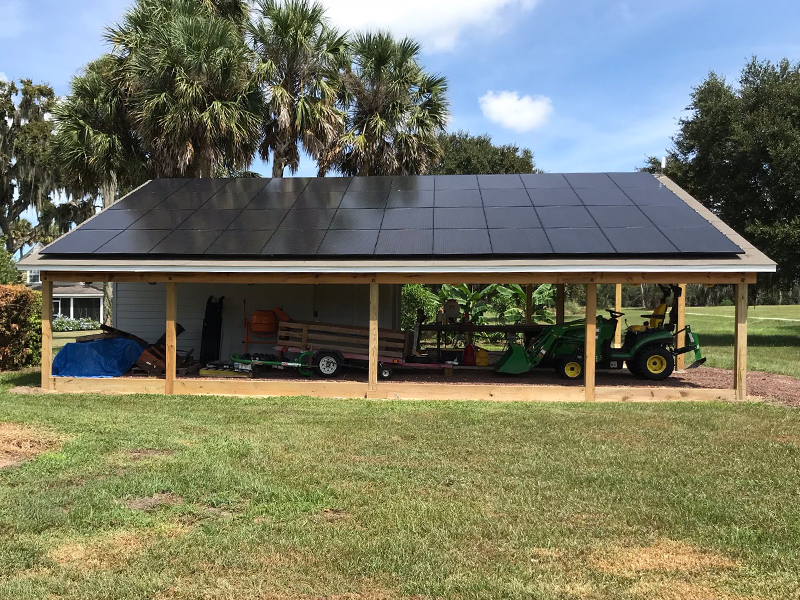 garage covered with solar panels to power their machines
