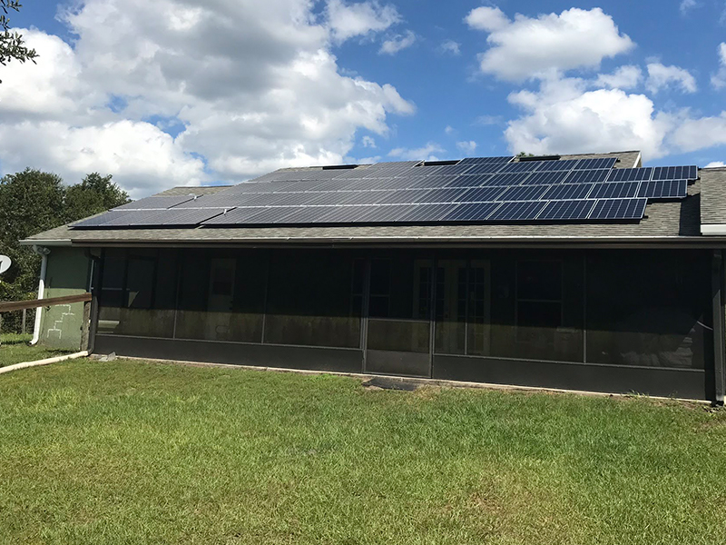 solar panels on one side of a house using energy from sun to power the house